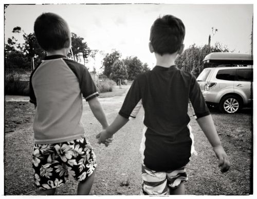 Twits holding hands